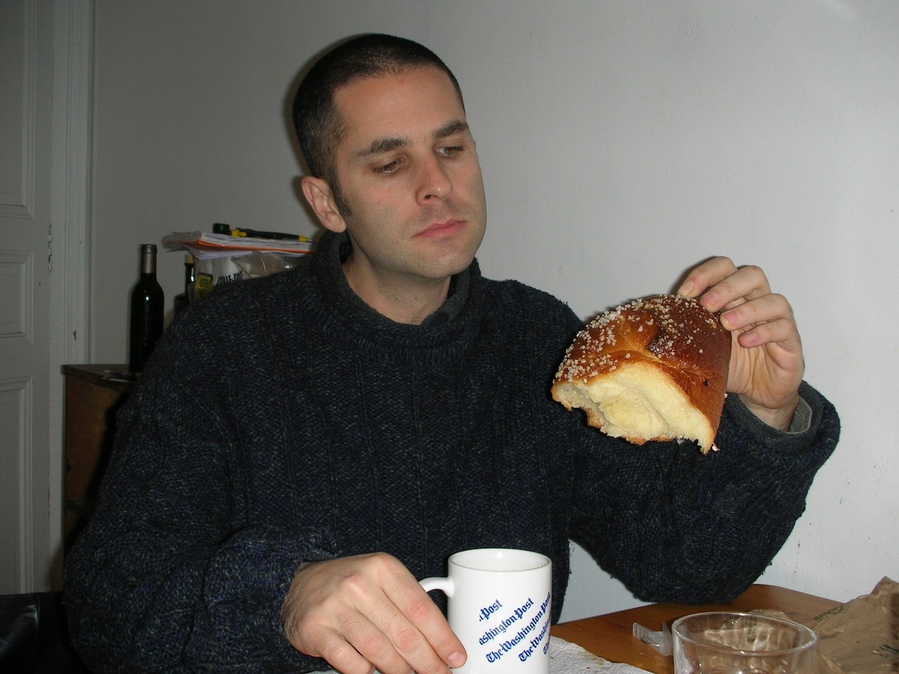 The author in Paris in 2008, thinking small thoughts with a big brioche