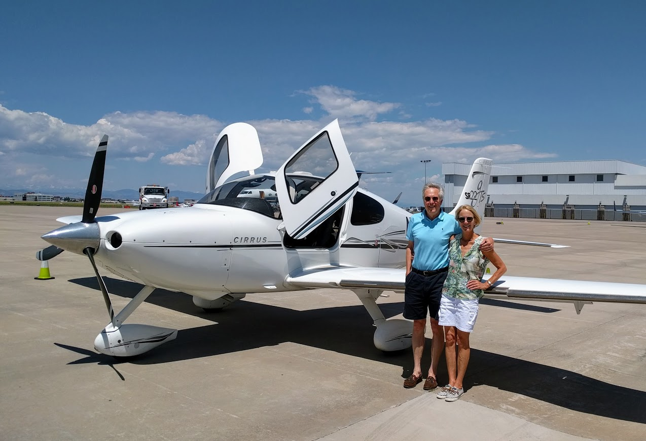 Photo of us with our plane.