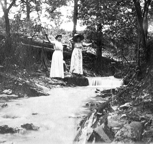 Laura on the left and Rose on the right standing in the ravine at Rocky Ridge Farm. Courtesy Herbert Hoover Presidential Library.