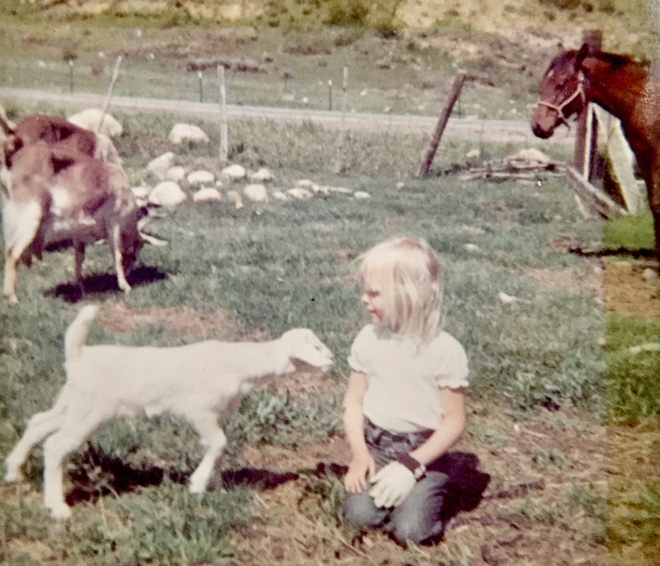 Photo: Jenny Forrester as a child posing with a goat.