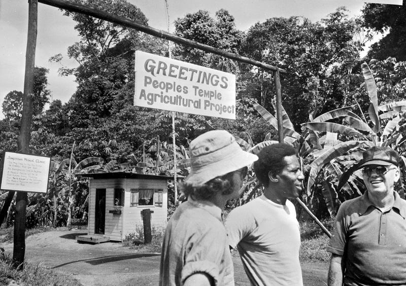 Photo: Men in front of Jonestown medical clinic.