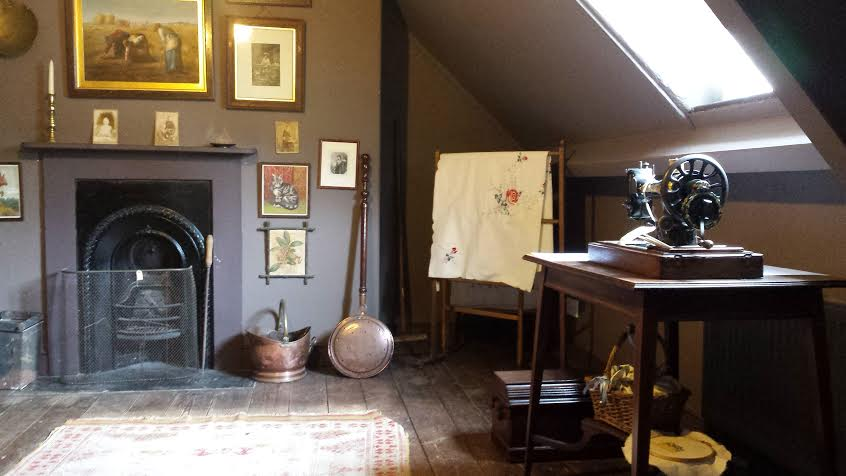A room with a fireplace in the attic of Thomas Hardy's house in Dorchester.