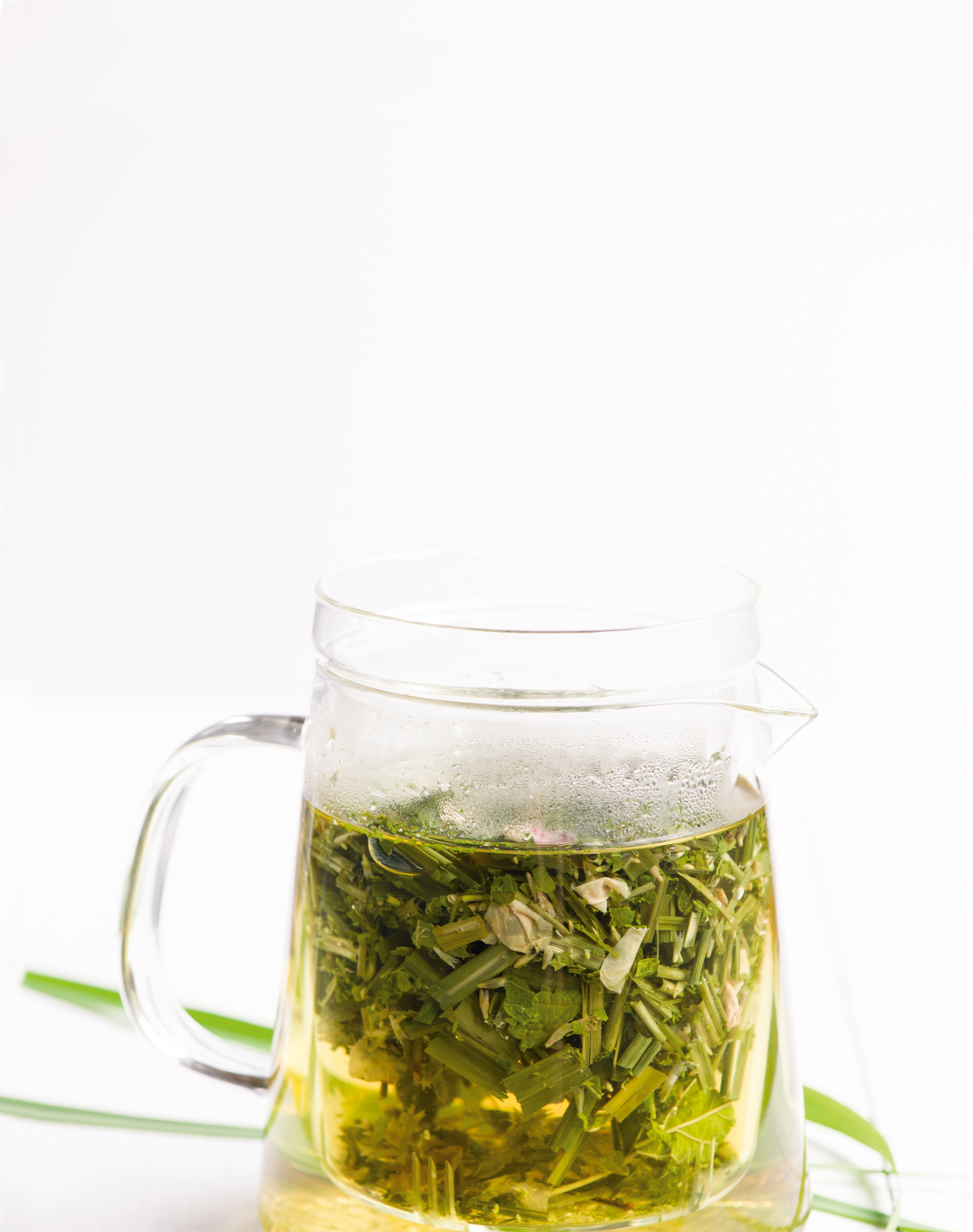 A clear mug filled with brewing tea.