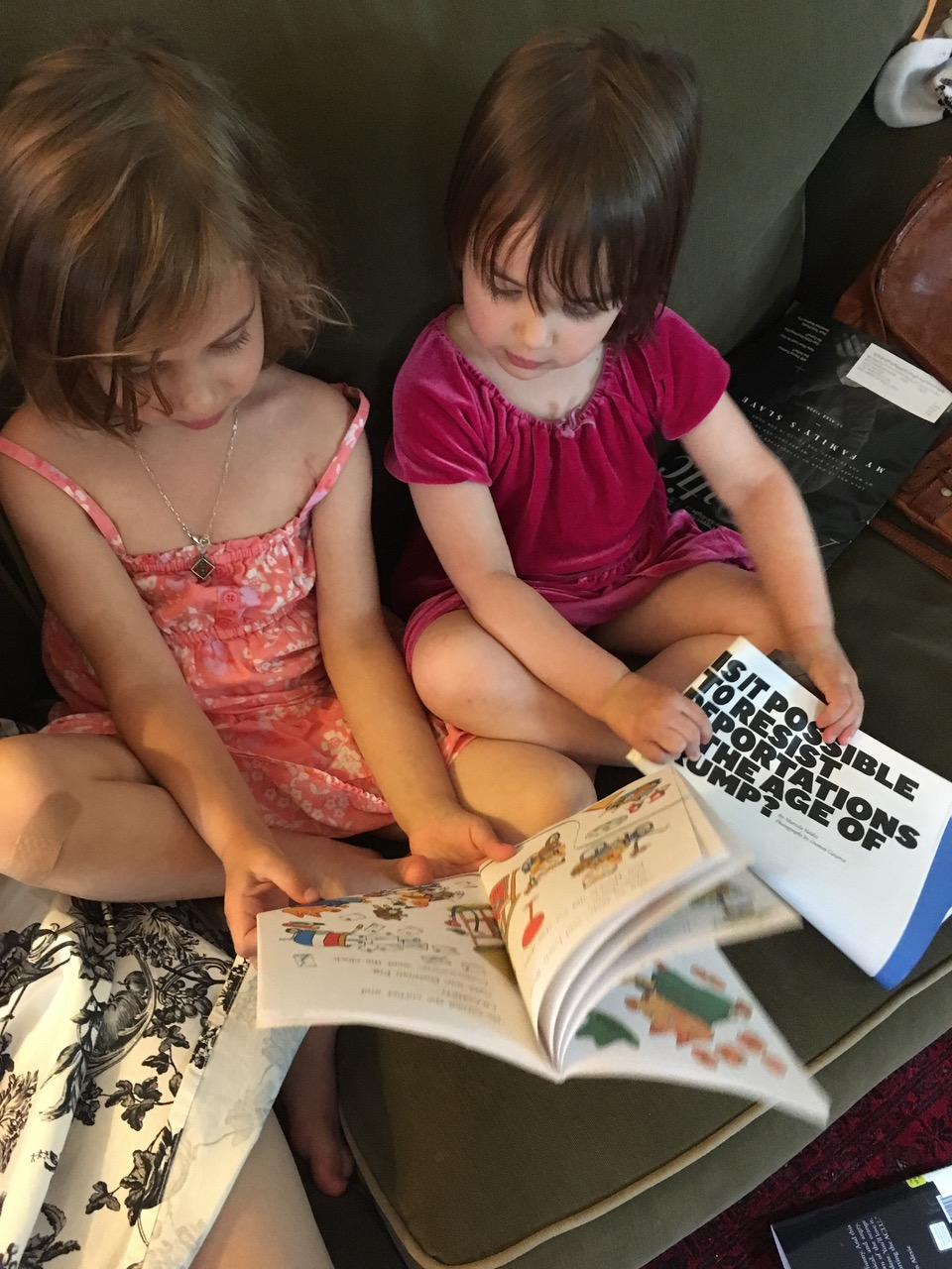 Rosenwaike's children sitting next to each other with a book and a newspaper.