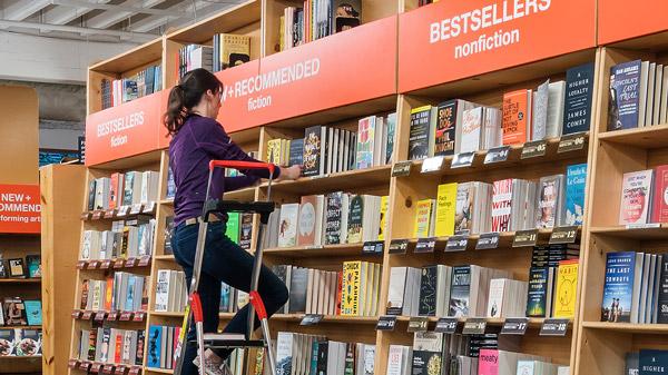 Powell's Books employee stocking shelves